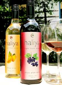 Hlaiya - mango and black plum wine bottles